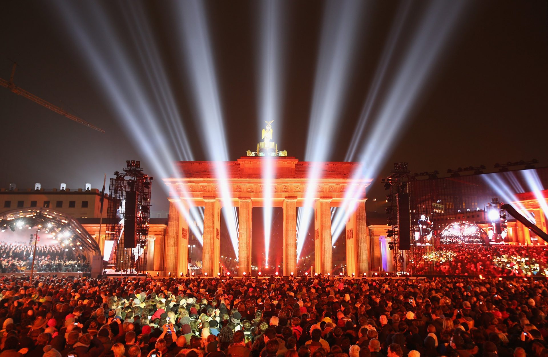 Light shines through the Brandenburg Gate during celebrations on the 25th anniversary of the fall of the Berlin Wall on November 9, 2014. Photo by Sean Gallup/Getty Images.
