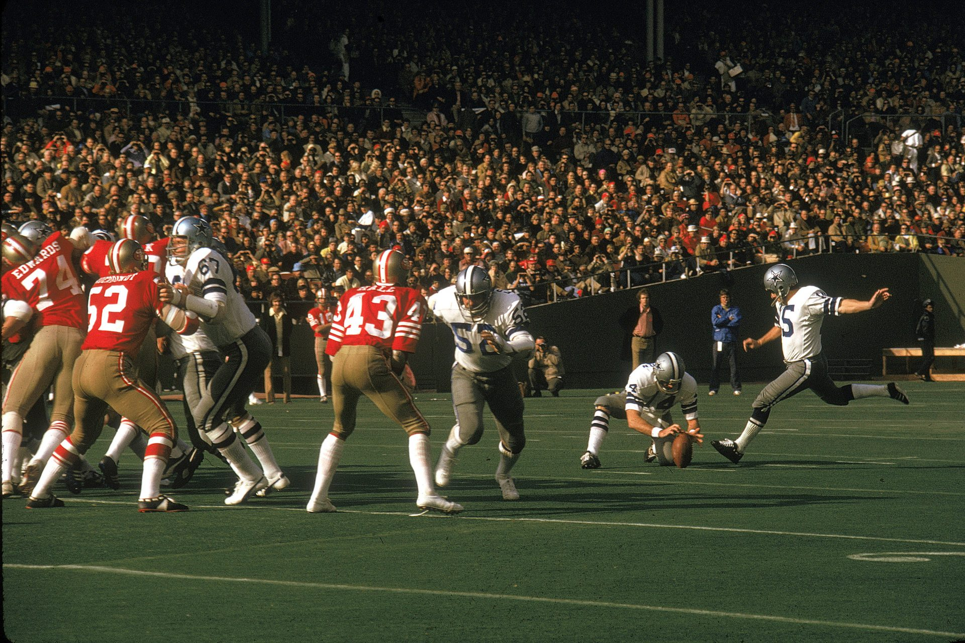 Toni Fritsch, on the far right, kicks one of three sucessful field goals for the Dallas Cowboys against the San Francisco 49ers in a 1972 NFC playoff game Candlestick Park, San Francisco. The Cowboys defeated the 49ers 30-28. Credit: James Flores/ Getty Images