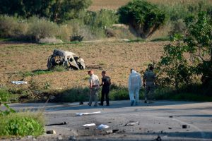 Police and forensic experts inspect the wreckage of a car bomb which killed journalist Daphne Caruana Galizia in Malta, in 2017. One man has been jailed for her murder, which has been linked to a wider conspiracy involving senior Maltese establishment figures. Photo: STR/AFP via Getty Images