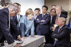 As other global leaders look on, Angela Merkel leads a debate with then US president Donald Trump at the 2018 G7 summit in Canada. Photo: Jesco Denzel / Bundesregierung