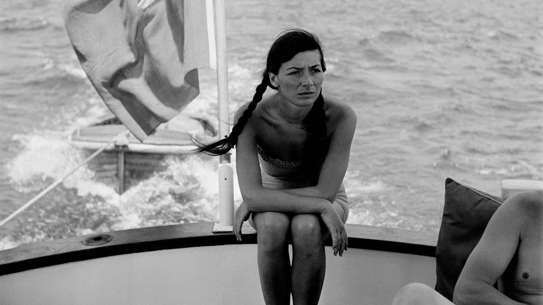 Juliette Gréco, seated in the stern of a boat off the coast of France, in 1950. Credit: REPORTERS ASSOCIES/Gamma- Rapho via Getty Images)