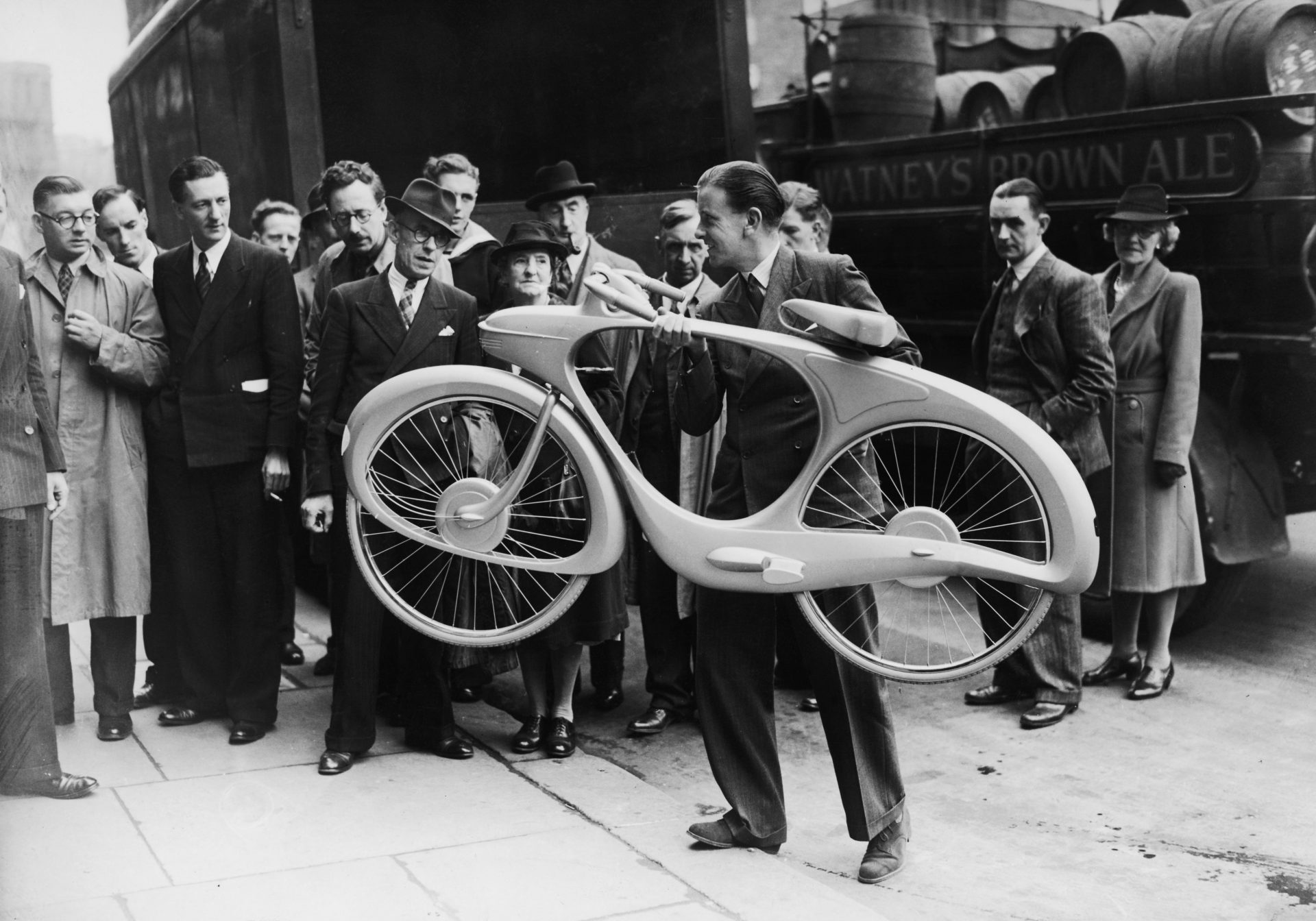 Designer B.G. Bowden with his 'Streamline' cycle, exhibited at the Britain Can Make It show. Features included a hub dynamo/motor, which stored energy while the bicycle was travelling downhill and released it on uphill gradients, as well as a radio. Credit: J. A. Hampton/Getty