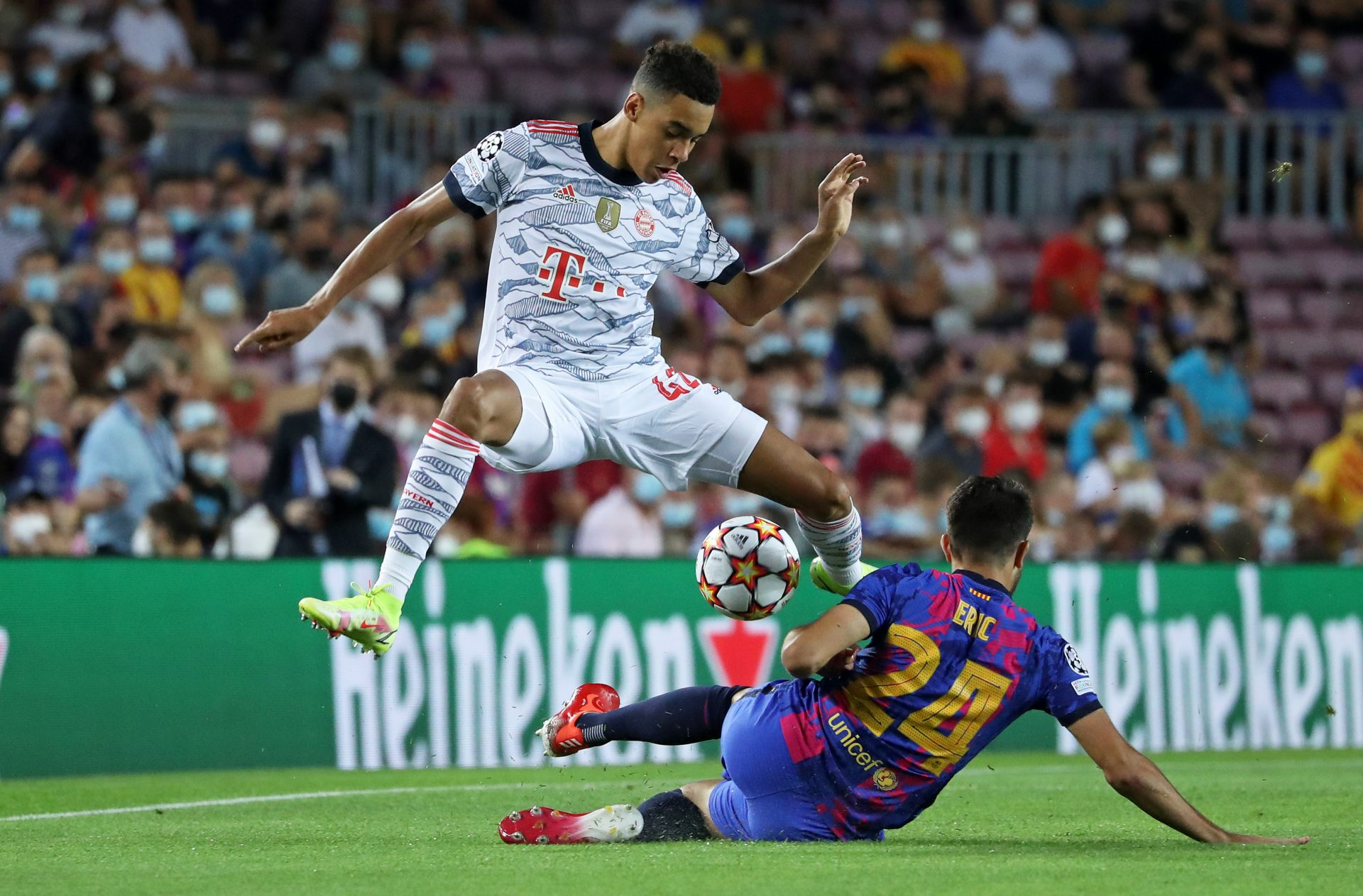 Jamal Musiala of Bayern Munich leaps over the challenge of Barcelona's Eric Garcia during their 3-0 win at Camp Nou in the Champions League opener Photo: Urbanandsport/ NurPhoto via Getty Images