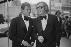 Roger Moore and Michael Caine attend the premiere of Sleuth at the Odeon near Marble Arch, May 1973. Credit: M. Stroud/Daily Express/Hulton Archive/Getty Images