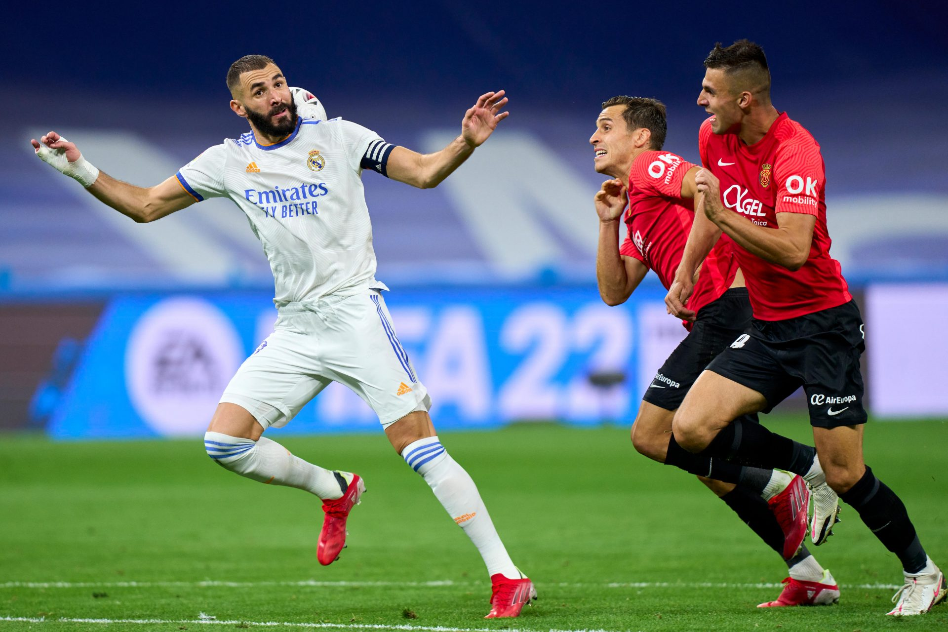 Spot the ball... Karim Benzema controls the ball before scoring against Mallorca in a recent match. Below, Real Madrid president Florentino Pérez. Credit: 2021 Quality Sport Images/Getty
