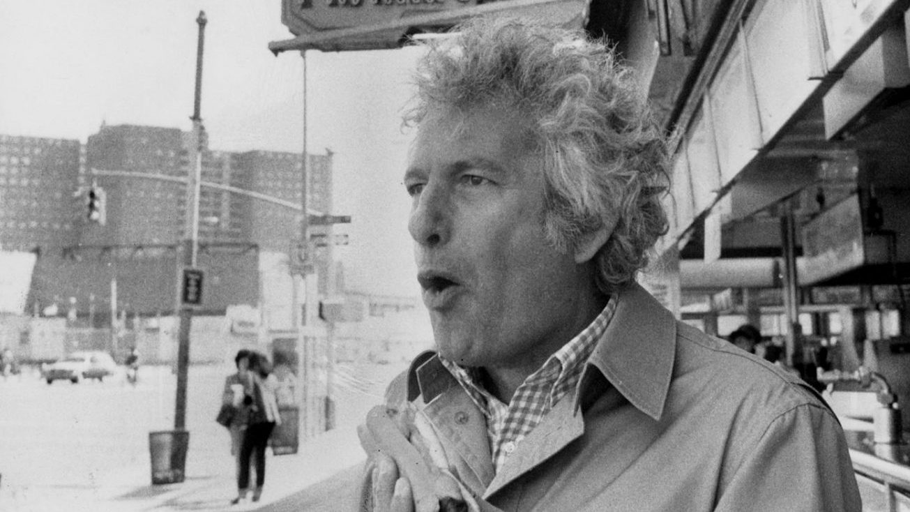 Author Joseph Heller eats a Nathan's Famous hot dog in Coney Island. Heller grew up in a low-income housing project in the Brooklyn neighbourhood Photo: Ed Molinari/NY Daily News Archive via Getty Images