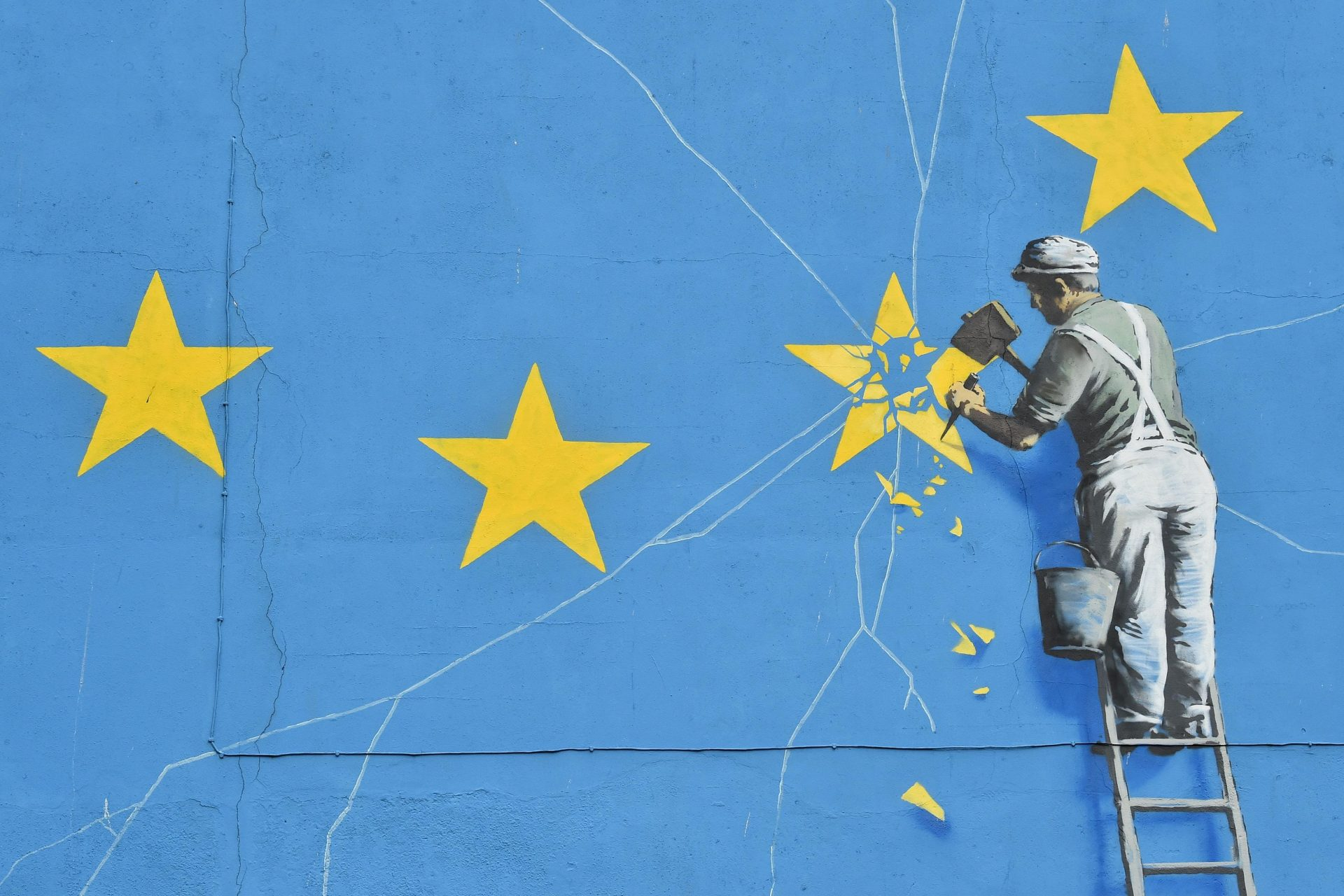 A 2017 mural by Banksy in Dover, depicting a workman chipping away at one of the stars on the European flag. Photo: Glyn Kirk/Getty Images.