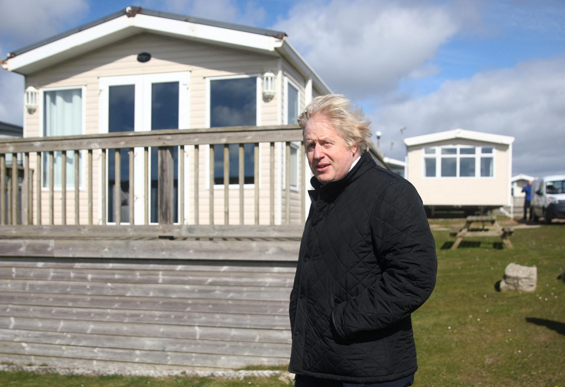 Boris Johnson visits a caravan park in Cornwall, before going somewhere far more glamorous on his own holiday. Photo: Tom Nicholson/Pool/AFP via Getty Images.