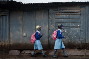 Pupils walk to school in Kibera slum, Nairobi, after a lengthy closure due to Covid-19. For most pupils, a whole year of school was cancelled. Photo: Yasuyoshi Chiba/AFP via Getty Images.