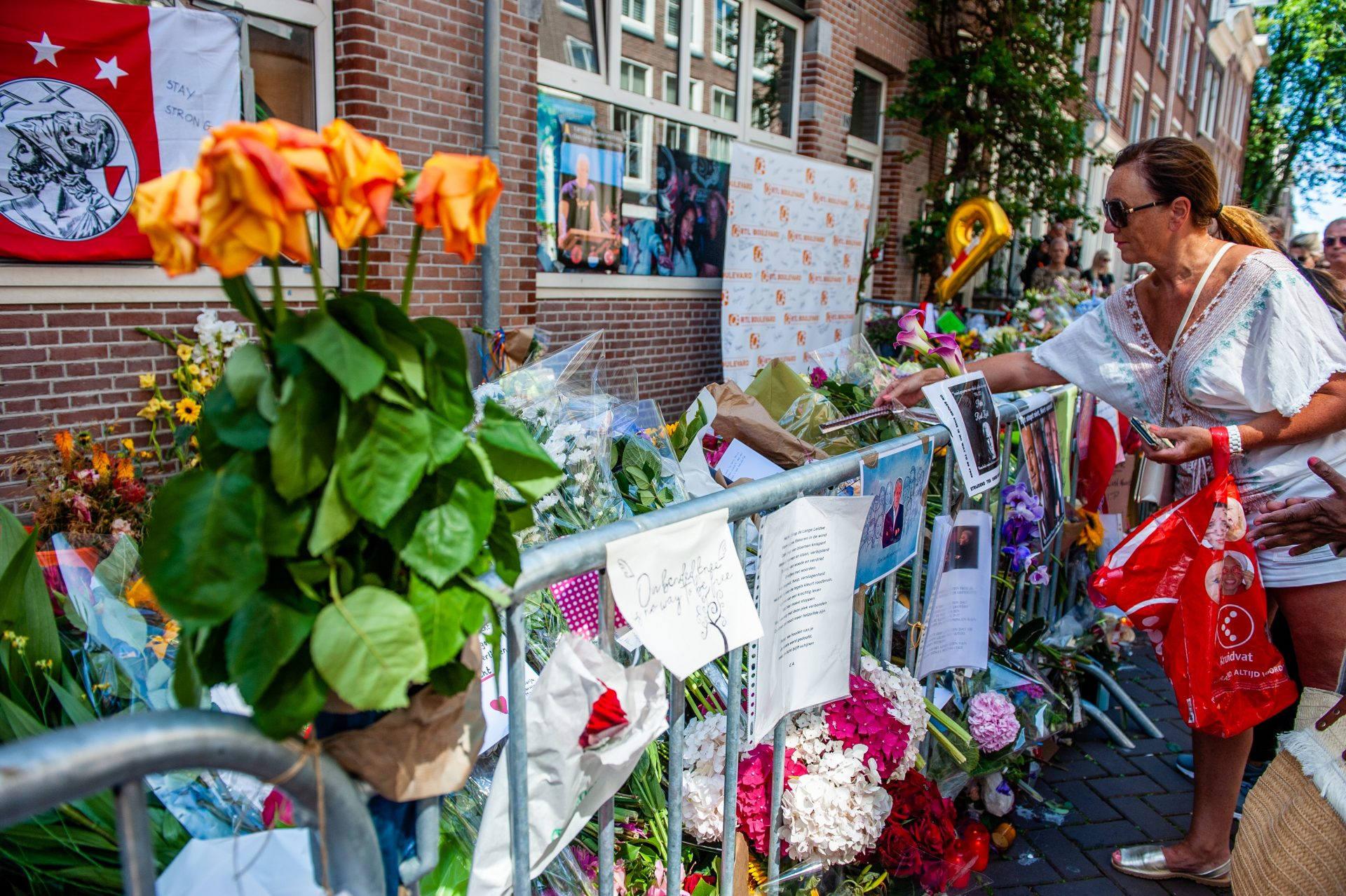 Flowers are laid at the scene of the murder of Peter de Vries earlier this year. Picture: Getty Images.