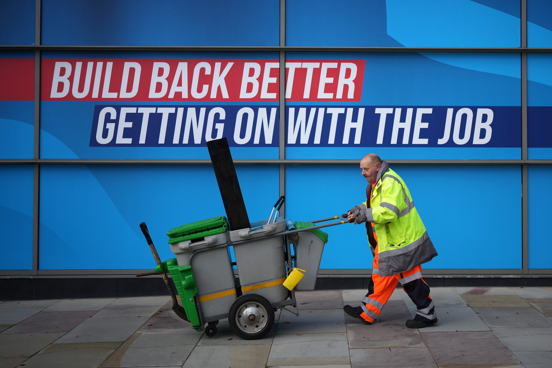 Who is most trusted not to make a mess? A street cleaner walks past a poster at the Conservative Party conference in Manchester this week. Photo by Christopher Furlong/Getty