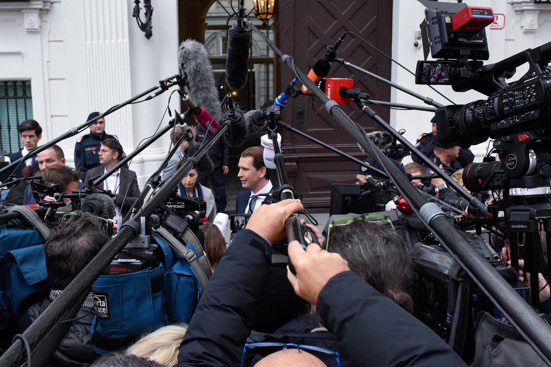 Man in the middle.. Sebastian Kurz at the centre of a media frenzy as the scandal around him deepened. Photo: Thomas Kronsteiner/Getty Images.