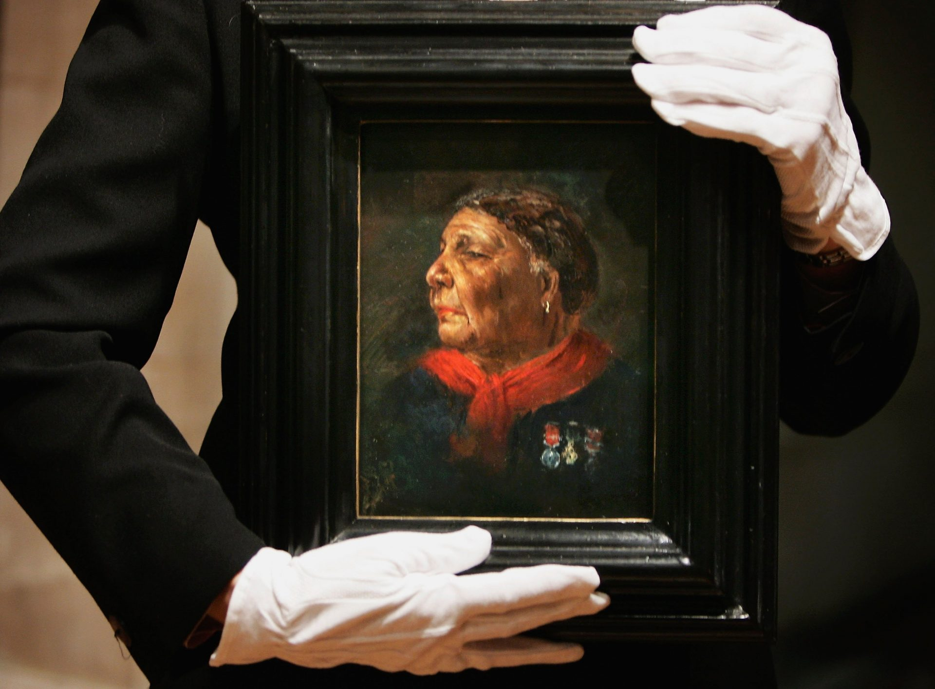 Writer and historian Helen Rappaport, holds a portrait of Mary Seacole by  Albert Challen dated 1869, in the National Portrait Gallery. (Photo by Bruno Vincent/Getty Images)