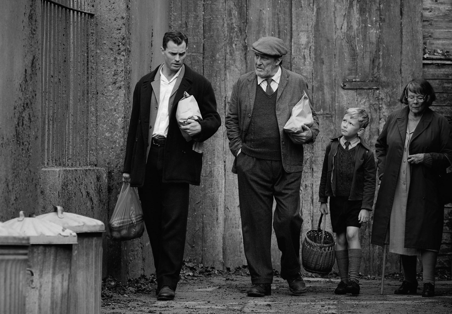 Jamie Dornan as Pa, Ciarán Hinds as Pop, Jude Hill as Buddy, and Judi Dench as Granny in Belfast Photo: Rob Youngson / Focus Features