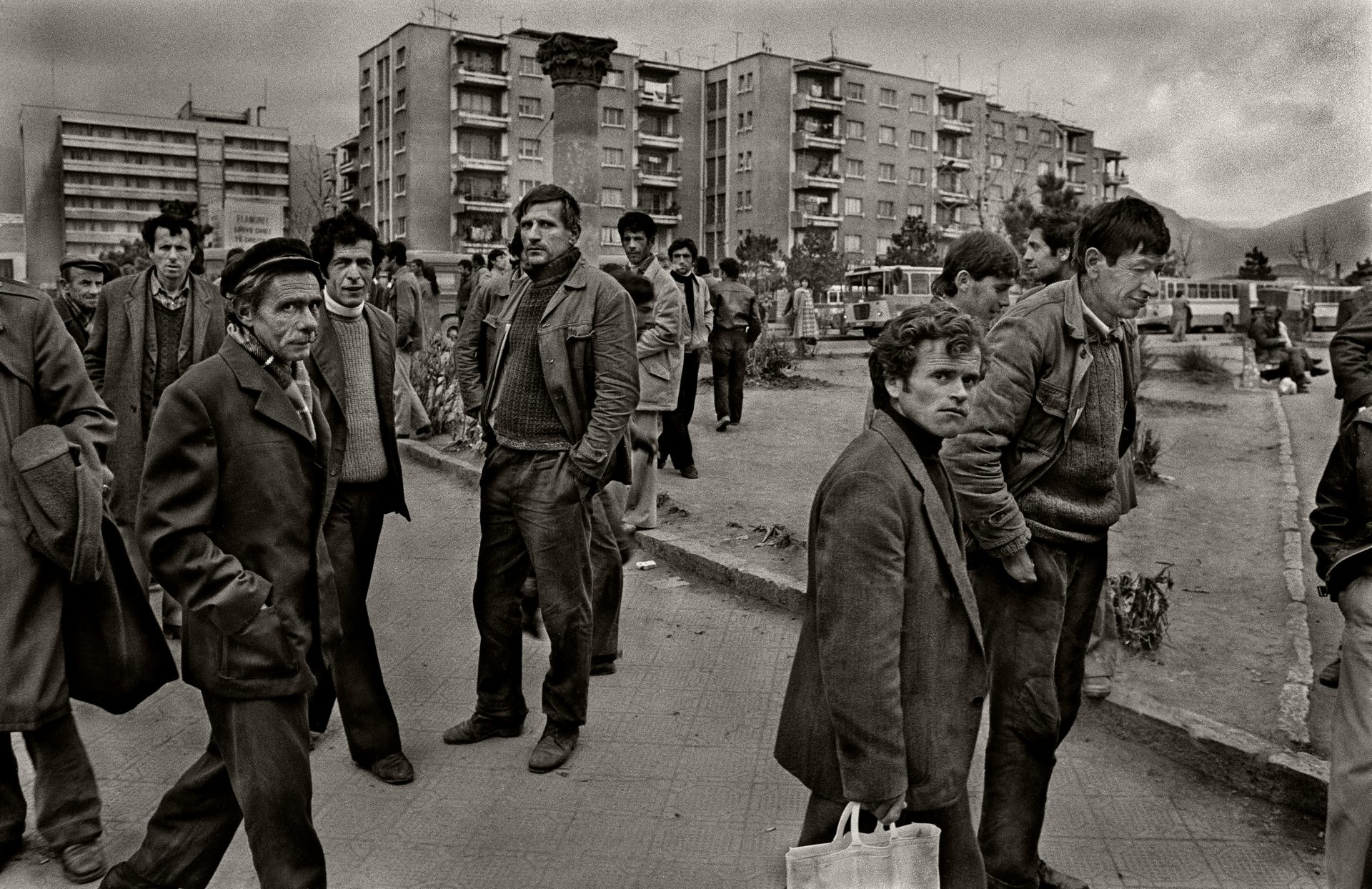 Locals in the centre of Korçë, in eastern Albania, look wary when photographed in June 1990. The communist regime remained in place, but its downfall was looming. Suspicion of foreigners was encouraged and anyone seen in conversation with them was questioned by the Sigurimi  Photo: Pictures Ltd./Corbis via Getty Images