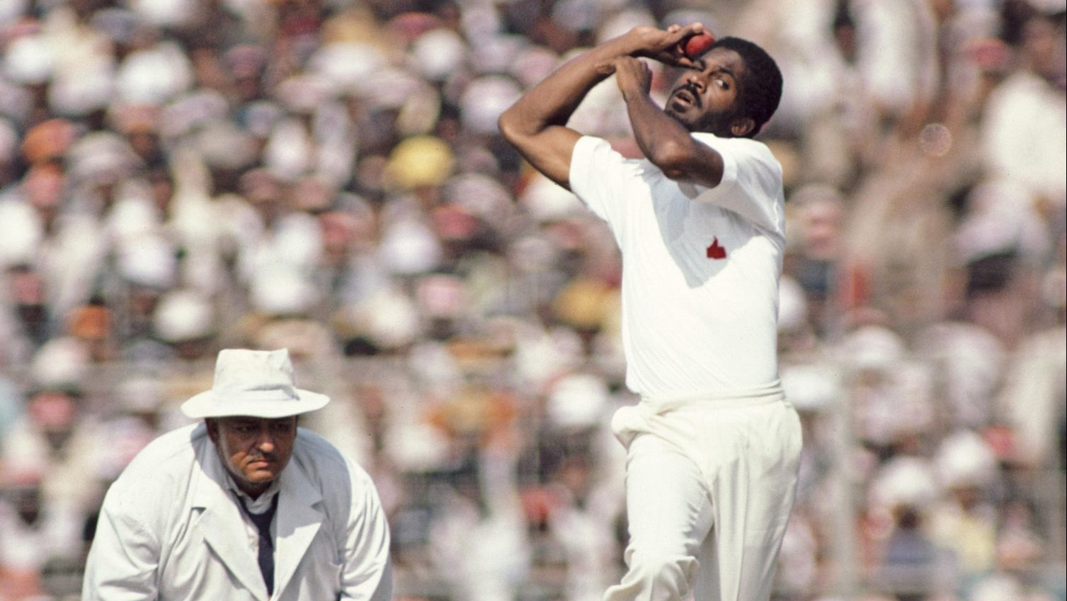 Michael Holding in action for the West Indies in a Test against India in 1983, as umpire Swaroop Kishen looks on. Credit: Hulton Archive/Getty