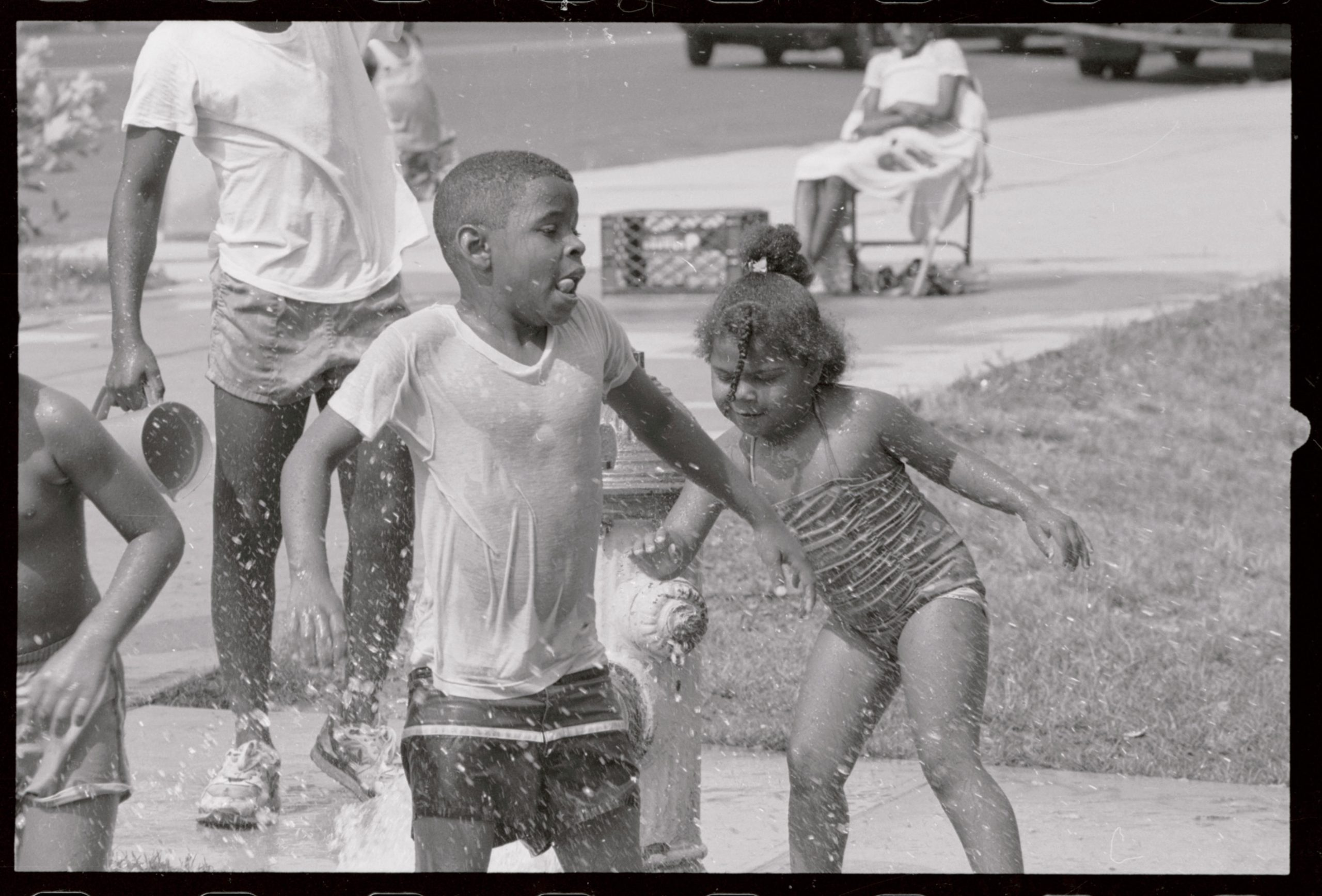 Children play in water from a hydrant in Newark, New Jersey, during the United States' 1988 heatwave.